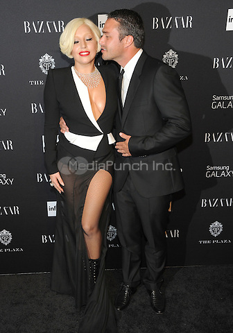 New York, NY-September 5: Lady Gag and Taylor Kinney  attend Harper's Baazar Celebrates Icons By Carine Roitfeld on September 5, 2014 at the Plaza Hotel in New York City. Credit: John Palmer/MediaPunch
