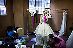 JOHANNESBURG, SOUTH AFRICA - FEBRUARY 14: A model is dressed for the KLuK CGDT label during a fitting in preparation for the Joburg Fashion Week on February 14, 2011, in Johannesburg, South Africa. KLuK CGDT, created by the designers Malcolm KLuK and Christiaan Gabriel Du Toit and their brand is not so much about clothes, but rather life and a holistic experiential, boundary blurring approach to style that encompasses all the senses. Trends influencing their collection include touches of tribal, vintage and the baroque. Their couture collection only to order. (Photo by Per-Anders Pettersson)