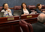 Neavda Assembly Democrats Dina Neal, left, and Teresa Benitez-Thompson joke with Assemblyman John Ellison, R-Elko, before a committtee hearing at the Legislative Building in Carson City, Nev., on Wednesday, May 15, 2013. Several members of the Assembly Government Affairs committee wore fake red nails in honor of Peggy Pierce who has been ill..Photo by Cathleen Allison