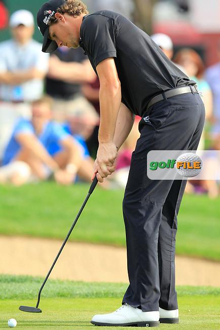 Thomas Pieters (BEL) putts on the 13th green during Sunday's Final Round of the Abu Dhabi HSBC Golf Championship 2015 held at the Abu Dhabi Golf Course, United Arab Emirates. 18th January 2015.<br /> Picture: Eoin Clarke www.golffile.ie