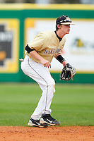 Shortstop Jack Fischer #15 of the Wake Forest Demon Deacons on defense against the LSU Tigers at Alex Box Stadium on February 20, 2011 in Baton Rouge, Louisiana.  The Tigers defeated the Demon Deacons 9-1.  Photo by Brian Westerholt / Four Seam Images