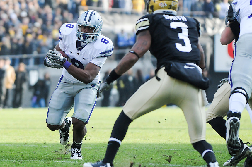 NOVEMBER 20, 2010:  Kansas State running back Daniel Thomas runs as Colorado cornerback Jimmy Smith defends during a Big XII conference game between the Kansas State Wildcats and the University of Colorado Buffaloes at Folsom Field in Boulder, Colorado. The Buffaloes beat the Wildcats 44-36. *****For editorial use only*****