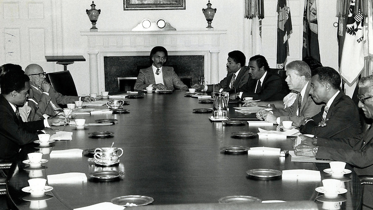 UNITED STATES: File photo - Members of the Congressional Black Caucus meet with Pres. Jimmy Carter at the Oval Office in 1977. From left to right: Del. Walter Fauntroy (D-D.C.), Rep. Augustus Hawkins (D-Calif.), Rep. Ron Dellums (D-Calif.), Rep. William Clay, Sr. (D-Mo.), Rep. Charles Rangel (D-N.Y.), Pres. Jimmy Carter, Rep. Parren Mitchell (D-Md.), Rep. Ralph Metcalfe (D-Ill.) (Photo courtesy of William Clay, Sr.)