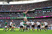 Devin Toner of Ireland rises high to win lineout ball. Rugby World Cup Pool D match between Ireland and Romania on September 27, 2015 at Wembley Stadium in London, England. Photo by: Patrick Khachfe / Onside Images