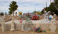 Miniature Religiuos Statues at a grave at the old Mexican cemetery in Tubac Arizona.