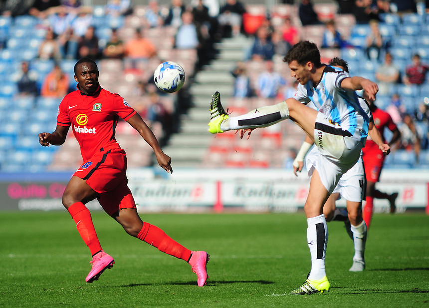 Huddersfield Town's Mark Hudson clears as he is closed down by Blackburn Rovers' Bengadli-Fode Koita<br /> <br /> Photographer Andrew Vaughan/CameraSport<br /> <br /> Football - The Football League Sky Bet Championship - Huddersfield Town v Blackburn Rovers - Saturday 15th August 2015 - The John Smith's Stadium - Huddersfield<br /> <br /> &copy; CameraSport - 43 Linden Ave. Countesthorpe. Leicester. England. LE8 5PG - Tel: +44 (0) 116 277 4147 - admin@camerasport.com - www.camerasport.com