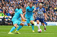 Neal Maupay of Brighton and Hove Albion right vies with Eric Dier and Toby Alderweireld of Tottenham Hotspur during Brighton & Hove Albion vs Tottenham Hotspur, Premier League Football at the American Express Community Stadium on 5th October 2019