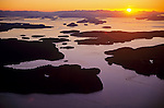 Island County, WA<br /> Aerial  view of the San Juan Islands with Shaw island and the Wasp island group at sunset