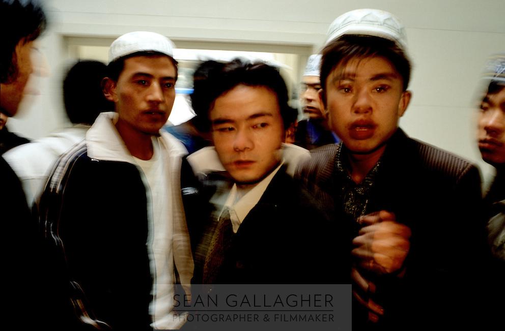CHINA. Beijing. Men in Niu Jie Mosque during the festival of Eid-al-Fitr, marking the end of Ramadan. 2005