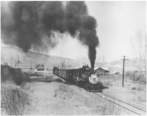 D&amp;RGW #318 with southbound freight on Ouray Branch.  The Ridgway depot is in the left distance.<br /> D&amp;RGW  Ouray Branch, CO