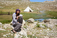 Munzur Mountains, Turkey  - July 22, 2014 - A young woman from the Munzur Valley, in the high meadows of the Munzur Mountains, where she spends the summers with her family and their herds of sheep and goats. She is ready to abandon her nomadic way of life, prefering to stay where she can have electricity and cell phone service year-round. CREDIT: Michael Benanav for The New York Times