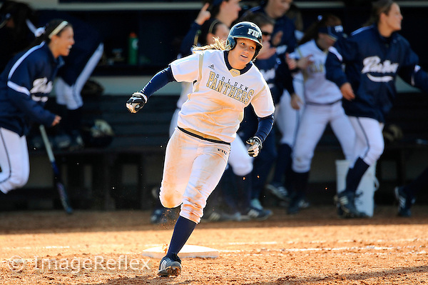13 February 2010:  FIU's Kayla Burri (7) enjoys a trip around the bases after hitting a home run as the FIU Golden Panthers defeated the Southern Illinois Salukis, 10-6, at the University Park Stadium in Miami, Florida.