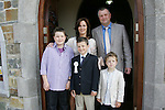 Conor Faulkner, who made his First Communion on Saturday at Clogherhead church, pictured with mum Karen, dad Ronan and brothers David and Padraig.