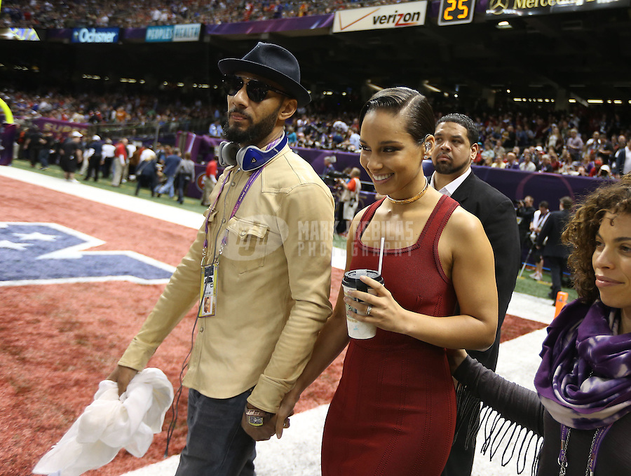 Feb 3, 2013; New Orleans, LA, USA; Recording artist Alicia Keys (right) with husband Swizz Beatz before Super Bowl XLVII between the San Francisco 49ers and the Baltimore Ravens at the Mercedes-Benz Superdome. Mandatory Credit: Mark J. Rebilas-