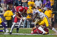 NWA Democrat-Gazette/BEN GOFF @NWABENGOFF<br /> Jonathan Nance, Arkansas wide receiver, braces for a hit from Donnie Alexander (48), LSU linebacker, after a catch in the first quarter Saturday, Nov. 11, 2017 at Tiger Stadium in Baton Rouge, La.