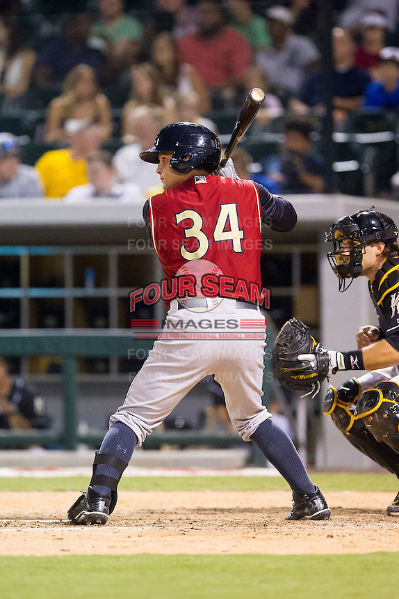John Ryan Murphy (34) of the Scranton/Wilkes-Barre RailRiders at bat against the Charlotte Knights at BB&T Ballpark on July 17, 2014 in Charlotte, North Carolina.  The Knights defeated the RailRiders 9-5.  (Brian Westerholt/Four Seam Images)