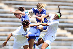 26 August 2012: Florida's Taylor Travis (41) and Jo Dragotta (left) challenge for the ball with Duke's Gilda Doria (left) and Kim DeCesare (right). The University of Florida Gators defeated the Duke University Blue Devils 3-2 in overtime at Fetzer Field in Chapel Hill, North Carolina in a 2012 NCAA Division I Women's Soccer game.