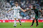 Luka Modric (l) of Real Madrid is tackled by Victor Camarasa Ferrando of Real Betis during the La Liga 2017-18 match between Real Madrid and Real Betis at Estadio Santiago Bernabeu on 20 September 2017 in Madrid, Spain. Photo by Diego Gonzalez / Power Sport Images