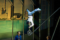 Shanghai Acrobatic Group perform a balancing act stunt on a tightrope, Shanghai Centre Theatre, China