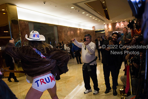 The Naked Cowboy poses for members of the media inside of Trump Tower in Manhattan, New York, U.S., on Friday, November 18, 2016. <br /> Credit: John Taggart / Pool via CNP