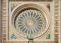 Detail of the rose window built by the sculptor and architect Orcagna between 1354 and 1380 on the14th century Tuscan Gothic style facade of the Cathedral of Orvieto, designed by Maitani, Umbria, Italy