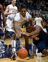 Richard Solomon of California fights for a loose ball against Stacy Davis of Pepperdine during the game at Haas Pavilion in Berkeley, California on November 13th, 2012.  California defeated Pepperdine, 79-62.