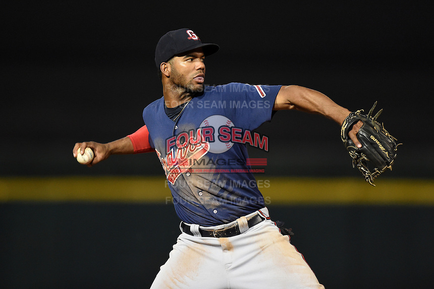 Gwinnett Braves third baseman Edward Salcedo (5) warmup throw to first during a game against the Buffalo Bisons on May 13, 2014 at Coca-Cola Field in Buffalo, New  York.  Gwinnett defeated Buffalo 3-2.  (Mike Janes/Four Seam Images)