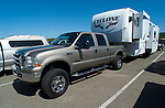 Ford towing fifth wheel trailer.