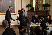 United States President Barack Obama greets attendees at an event for the Council on Women and Girls in the East Room of the White House in Washington, District of Columbia, U.S., on Wednesday, January 22, 2014. The President signed a Presidential Memorandum at the event Establishing a White House Task Force to Protect Students from Sexual Assault. <br /> Credit:  Pete Marovich / Pool via CNP