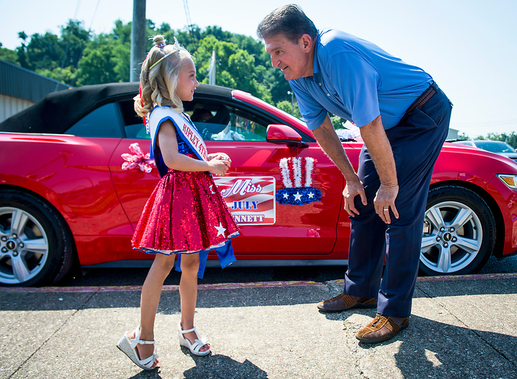 UNITED STATES - July 4: Sen. Joe Manchin, D-W.Va., chats with Little Miss 4th of July before the start of the Ripley 4th of July Grand Parade in Ripley, West Virginia<br /> Wednesday July 4, 2018. (Photo By Sarah Silbiger/CQ Roll Call)