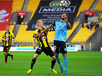 Adam Parkhouse and Milos Ninkovic compete for the ball during the A-League football match between Wellington Phoenix and Sydney FC at Westpac Stadium in Wellington, New Zealand on Saturday, 23 December 2017. Photo: Dave Lintott / lintottphoto.co.nz