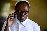 TANZANIA Mara, Tarime, village Masanga, region of the Kuria tribe who practise FGM Female Genital Mutilation, temporary rescue camp of the Diocese Musoma for girls which escaped from their villages to prevent FGM / TANSANIA Mara, Tarime, Dorf Masanga, in der Region lebt der Kuria Tribe, der FGM weibliche Genitalbeschneidung praktiziert, temporaerer Zufluchtsort fuer Maedchen, denen in ihrem Dorf Genitalverstuemmelung droht, in einer Schule der Dioezese Musoma, Schwestern DAUGHTERS OF CHARITY (ST. VINCENT DE PAUL), Schwester SR. GERMAINE BAIBIKA erhaelt Anrufe von bedrohten Maedchen aus den Doerfern