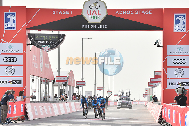 Movistar Team cross the finish line of Stage 1 of the 2019 UAE Tour, a team time trial running 16km around Al Hudayriat Island, Abu Dhabi, United Arab Emirates. 24th February 2019.<br /> Picture: LaPresse/Massimo Paolone | Cyclefile<br /> <br /> <br /> All photos usage must carry mandatory copyright credit (© Cyclefile | LaPresse/Massimo Paolone)