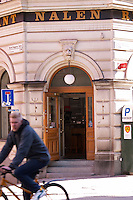 The exterior and entrance to the restaurant Nalen with a man passing by on bicycle. Stockholm, Sweden, Sverige, Europe