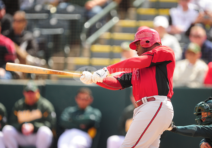 Mar. 19, 2012; Phoenix, AZ, USA; Arizona Diamondbacks outfielder Justin Upton bats in the third inning against the Oakland Athletics during a spring training game at Phoenix Municipal Stadium.  Mandatory Credit: Mark J. Rebilas-