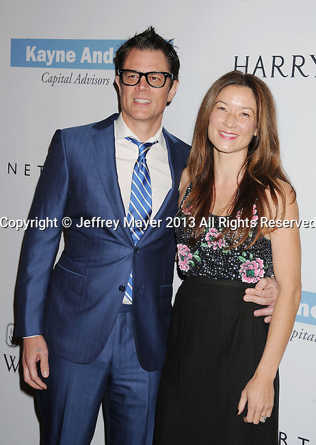 CULVER CITY, CA- NOVEMBER 09: Actor Johnny Knoxville (L) and Naomi Nelson arrive at the 2nd Annual Baby2Baby Gala at The Book Bindery on November 9, 2013 in Culver City, California.
