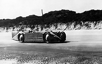 BNPS.co.uk (01202 558833)<br /> Pic: NMM/BNPS<br /> <br /> The Golden Arrow breaking the Land Speed Record at Daytona in 1929 - powered by a huge ice cooled 24 litre Napier Lion aero engine.<br /> <br /> Golden shot in the arm - Beautiful record breaker Golden Arrow is to receive new funding 90 years after smashing the Land speed record for Britain.<br /> <br /> The National Motor Museum at Beaulieu has been awarded £75,000 by Arts Council England to allow fresh research into the historic machine and the collections relating to it, as well as some conservation work on particularly fragile items.  <br /> <br /> The distinctive 1929 Golden Arrow was a wonder of its time, a harmonious blend of technology and design, produced a masterpiece of Art Deco expression which paved the way for two decades of unbroken British world record-breaking success.<br /> <br /> With Major Henry Segrave in the driving seat,  the arrow shattered its target and set a new Land Speed Record of 231.36mph at Daytona Beach in Florida in March 1929.
