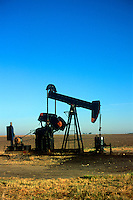 Oil well in Nebraska farm field<br />