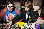 A team of adults took in a talented ten-year old teammate during the tournament. The young boy said he learned to read through playing Magic. <br /> <br /> Danny Ghitis for Bloomberg Businessweek