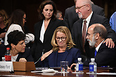 Christine Blasey Ford, the woman accusing Supreme Court nominee Brett Kavanaugh of sexually assaulting her at a party 36 years ago, chats with her attorneys as she testifies before the US Senate Judiciary Committee on Capitol Hill in Washington, DC, September 27, 2018.  / POOL / SAUL LOEB