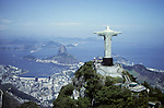 Rio de Janeiro, Brazil. Christ statue, aerial shot with the Sugarloaf behind. Corcovado mountain.