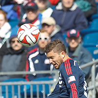 New England Revolution defender Chris Tierney (8) heads the ball.  In a Major League Soccer (MLS) match, the New England Revolution (blue/white) tied Vancouver Whitecaps FC (white), 0-0, at Gillette Stadium on March 22, 2014.