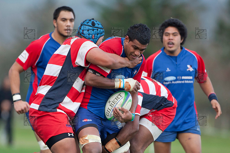 Sikeli Nabou gets well wrapped up by Tipiloma Kivalu and Seremaia Tagicakibau. Counties Manukau Premier Club Rugby game between Ardmore Marist and Karaka played at Bruce Pulman Park Papakura on Saturday June 11th 2011. Karaka won 42 - 25 after leading 21 - 18 at the break.