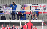 Lincoln City's head of performance analysis Stewart England, centre, on the TV gantry during the game<br /> <br /> Photographer Chris Vaughan/CameraSport<br /> <br /> The EFL Sky Bet League Two - Lincoln City v Morecambe - Saturday August 12th 2017 - Sincil Bank - Lincoln<br /> <br /> World Copyright &copy; 2017 CameraSport. All rights reserved. 43 Linden Ave. Countesthorpe. Leicester. England. LE8 5PG - Tel: +44 (0) 116 277 4147 - admin@camerasport.com - www.camerasport.com