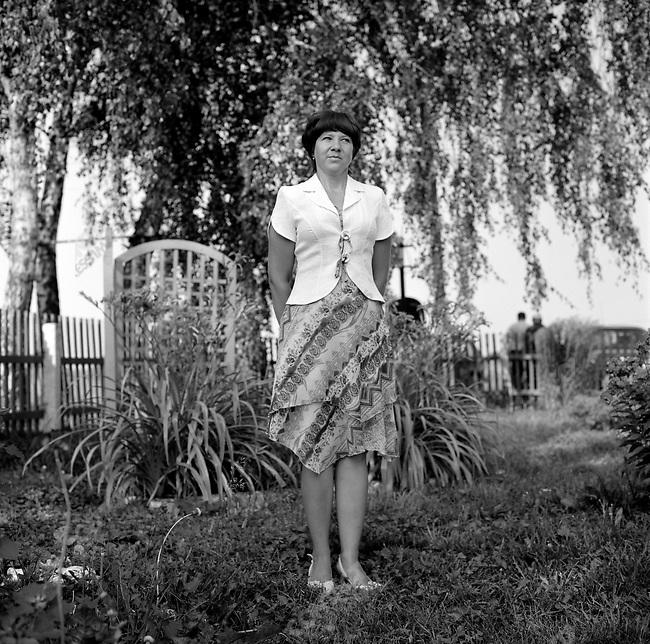 Oksana Fomina, chief account of the farm of the Resurrection near Mikhailov, Ryazan region. Russia, July 24, 2008.