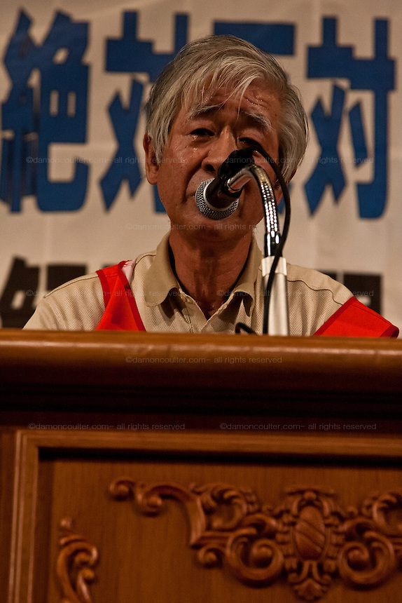 Kazuhiko Seino, former president of the Fukushima Prefecture Teachers' Union, along with other refugees from the nuclear accident in Fukushima, speaks at a rally by left wing groups, including Doro Chiba railway Union and Zengakuren students union, in Hibiya Park Hall in support of the abolition of nuclear power after the disaster at Fukushima Daichi nuclear plant. Hibiya Park, Tokyo, Japan. Sunday June 5th 2011