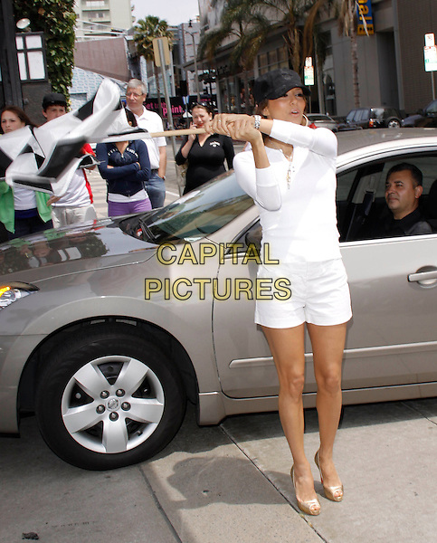 EVA LONGORIA PARKER .waving the checkered flag at The Rally for Kids with Cancer Scavenger Cup - Start Your Engines Brunch presented by Wonderwall from MSN at The Hollywood Roosevelt Hotel in Hollywood, California, USA, May 1st 2009.                                                                     .full length black cap hat white top shorts gold peep toe shoes platforms long sleeved car .CAP/DVS.©DVS/RockinExposures/Capital Pictures