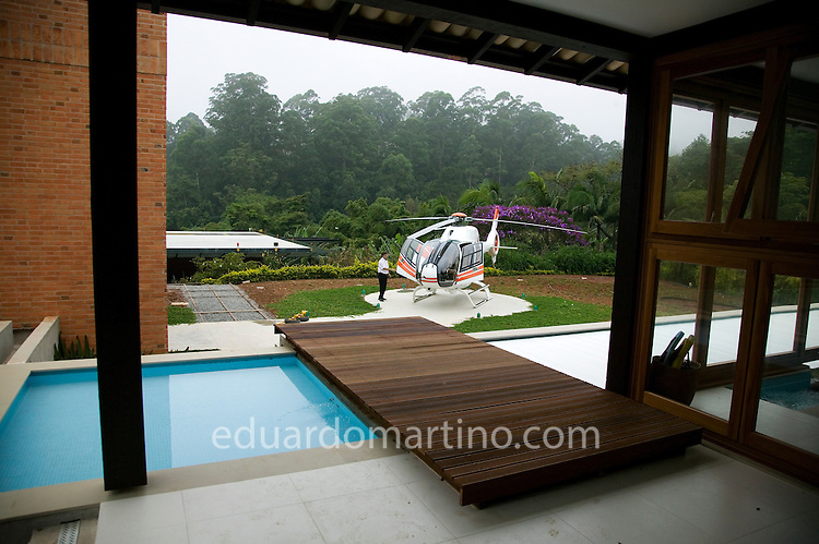 Private helicopter and helipad in a businessman's house in the outskirts of Sao Paulo.