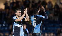 Matt Bloomfield of Wycombe Wanderers applauds the supporters during the Sky Bet League 2 match between Wycombe Wanderers and Oxford United at Adams Park, High Wycombe, England on 19 December 2015. Photo by Andy Rowland.