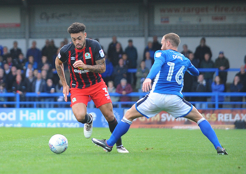 Blackburn Rovers' Derrick Williams under pressure from Rochdale's Matt Done<br /> <br /> Photographer Kevin Barnes/CameraSport<br /> <br /> The EFL Sky Bet League One - Rochdale v Blackburn Rovers - Saturday 9th September 2017 - Spotland Stadium - Rochdale<br /> <br /> World Copyright &copy; 2017 CameraSport. All rights reserved. 43 Linden Ave. Countesthorpe. Leicester. England. LE8 5PG - Tel: +44 (0) 116 277 4147 - admin@camerasport.com - www.camerasport.com